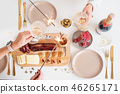 Christmas Family Dinner Table Concept. Christmas feast. Holiday Gold place setting, overhead shoot. 46265171