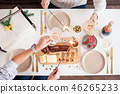 Christmas Family Dinner Table Concept. Christmas feast. Holiday Gold place setting, overhead shoot. 46265233