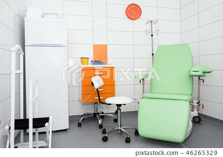 Modern and comfortable equipped hospital room. Treatment room with medicine in the fridge. 46265329