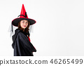 Woman in red witch halloween costume. 46265499