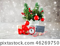 Christmas composition: xmas fir branches, alarm clock, gift box and decorations. 46269750