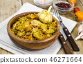 Rice with chicken meat and garlic in wooden bowl 46271664