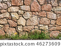 Stone Wall with Grass and Flowers - Background 46273609
