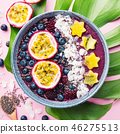 Smoothie acai bowl served in bowl on pink table 46275513
