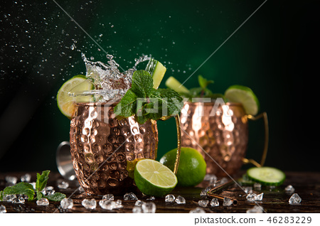 Famous Moscow mule alcoholic cocktail in copper mugs. 46283229