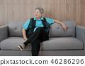old elderly woman smiling relaxing at home. happy elder senior sit on sofa 46286296