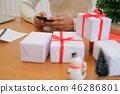 man using mobile smart phone with christmas decoration. xmas new year holiday celebration. 46286801