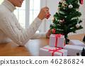 man decorating christmas tree. xmas new year holiday celebration. 46286824