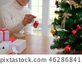 man decorating christmas tree. xmas new year holiday celebration. 46286841