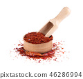 Dry and crushed chili pepper flakes isolated on white background. Red chili pepper in the wooden 46286994