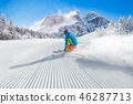 Skier skiing downhill in high mountains 46287713