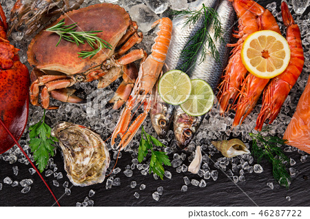 Fresh tasty seafood served on old wooden table. 46287722