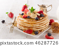 delicious pancakes on wooden table with fruits 46287726
