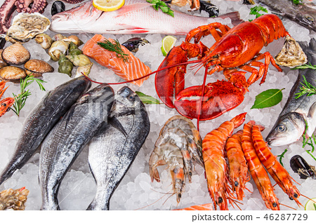 Fresh tasty seafood served on old wooden table. 46287729