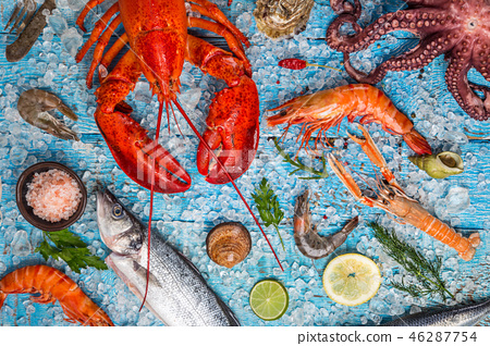 Fresh tasty seafood served on old wooden table. 46287754