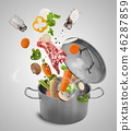 Fresh vegetables falling into stainless steel pot. 46287859