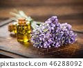 Wellness treatments with lavender flowers on wooden table. 46288092