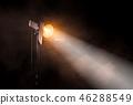 Theater spot light on black background. 46288549