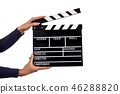 Clapperboard sign hold by female hands. 46288820