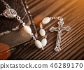 Closeup of iron Christian cross with holy Bible. 46289170