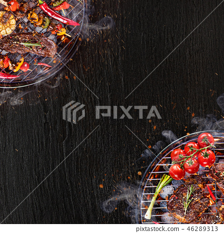 Barbecue grill with beef steaks, close-up. 46289313