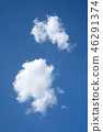 Two white clouds on blue sky 46291374