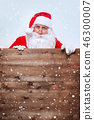 Santa Claus pointing in blank advertisement wooden banner with copy space 46300007