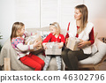 holidays, presents, christmas, x-mas, birthday concept - happy mother and child girl with gift box 46302796