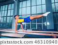beautiful boy is engaged in sports gymnastics on a parallel bars 46310940