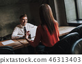 female discuss colleague 46313403
