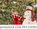 Happy child girl in santa costume play with snow 46315684