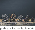Pine cones on a rustic wooden table 46322042