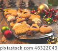 Tasty Christmas cookies with decoration 46322043