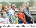 Family watching television 46322844