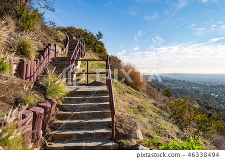 Stairs on observation deck on Hollywood Hills. Warm sunny day. Beautiful clouds in blue sky 46338494