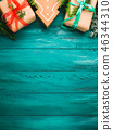 Christmas gift boxes on green background 46344310