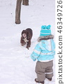 child dog outside winter season play snow 46349726