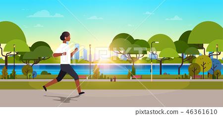 african american woman jogging outdoors modern public park girl headphones running sport activity 46361610