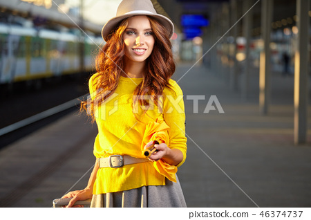 caucasian woman waiting at the railway station 46374737