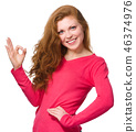 Woman is showing OK sign 46374976