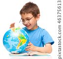 Little boy is examining globe 46375613