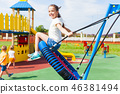 Various swings on the playground outdoors in the summer 46381494