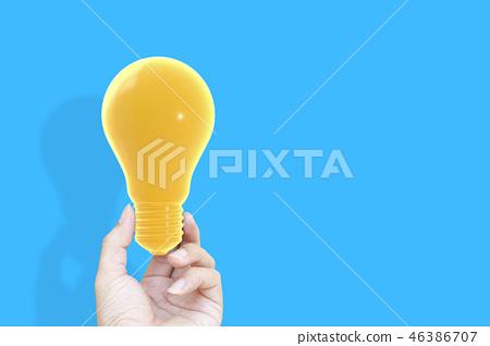 Hand holding houseHand holding light bulb 46386707