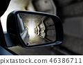 Tunnel in the sideview mirror of a car. 46386711
