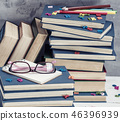 stack of books in a blue cover, pink glasses  46396939