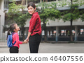 Mother holding hand  daughte to school 46407556