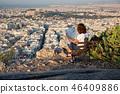 woman sitting on Lycabettus Hill 46409886