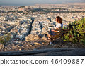 woman sitting on Lycabettus Hill 46409887