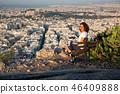 woman sitting on Lycabettus Hill 46409888