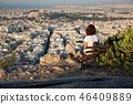 woman sitting on Lycabettus Hill 46409889
